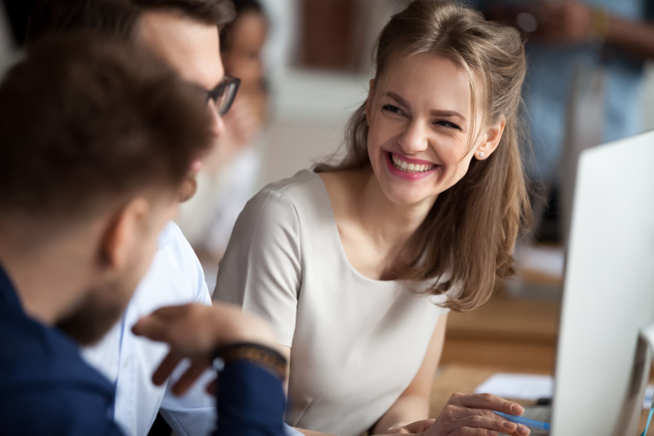 Woman smiling to coworkers