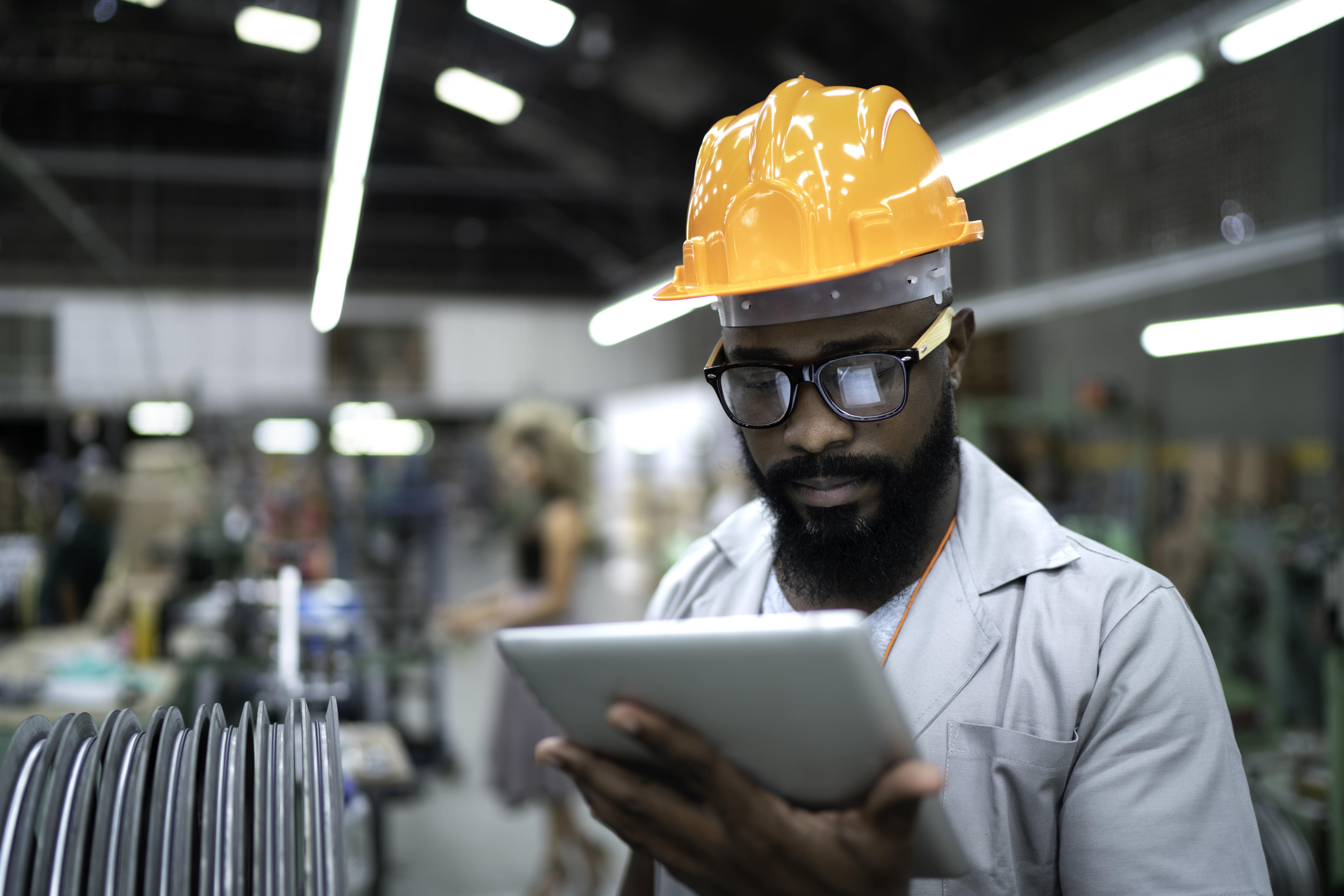 Man looking at iPad